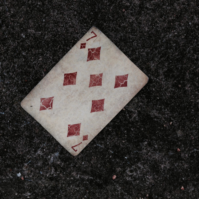 """Playing card on concrete background"" stock image"