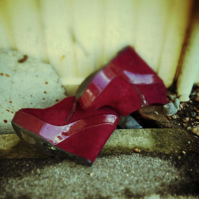 """""""A discarded pair of ladies red platform shoes left outside after a night out"""" stock image"""