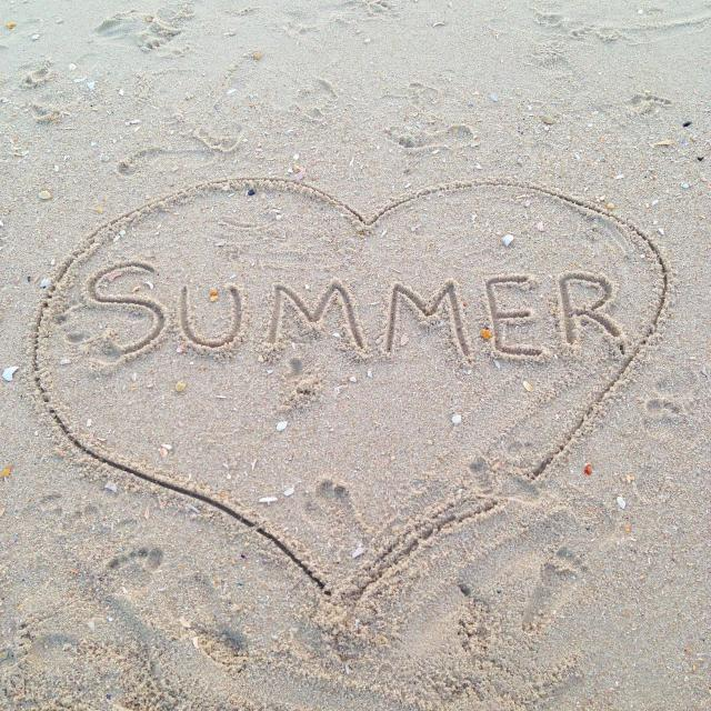 """The word summer handwritten in the sand in a beach."" stock image"