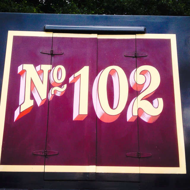 """Number 102 lettering on narrowboat"" stock image"