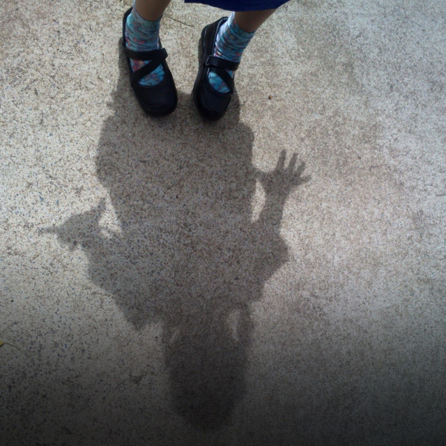 """Shadow of a very scared little girl."" stock image"