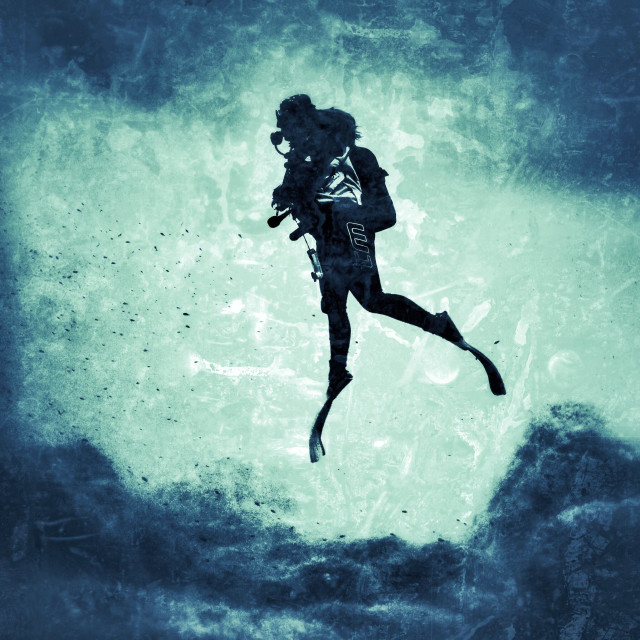 """""""Young female scuba diver ascending to the surface"""" stock image"""
