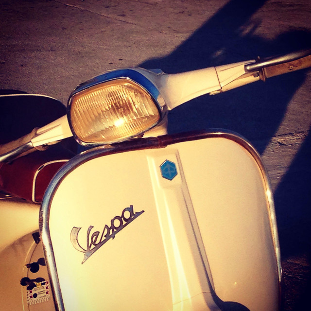 """Front end of classic Vespa motorcycle"" stock image"