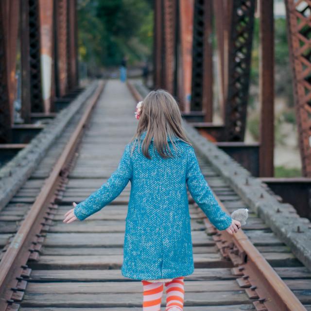 """walking on a vintage traintrack, turned into a pedestrian bridge"" stock image"