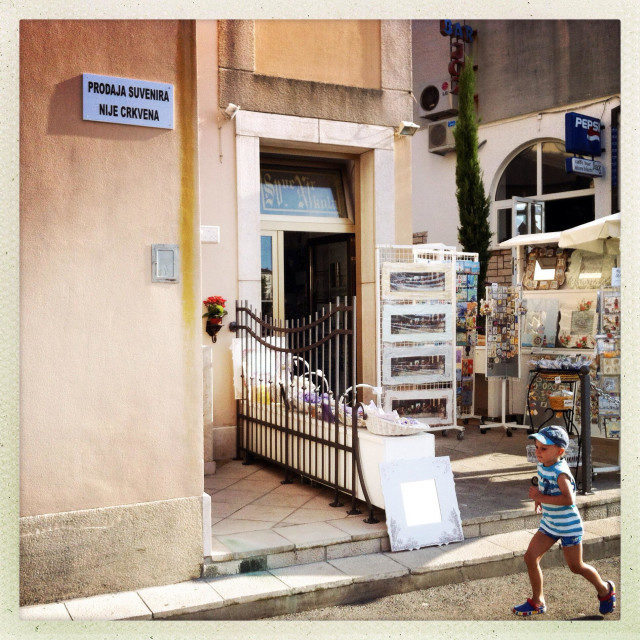 """Sign on a church says ""Souvenir shop is not part of Church"", Krk, Croatia"" stock image"