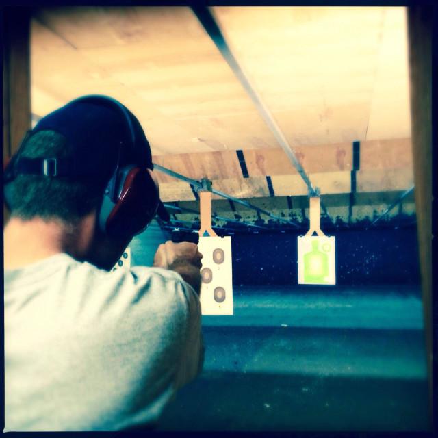 """""""Man at gun range"""" stock image"""