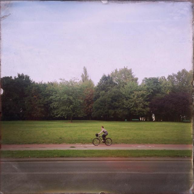 """A cyclist is seen near Manufaktura in Lódz, Poland."" stock image"