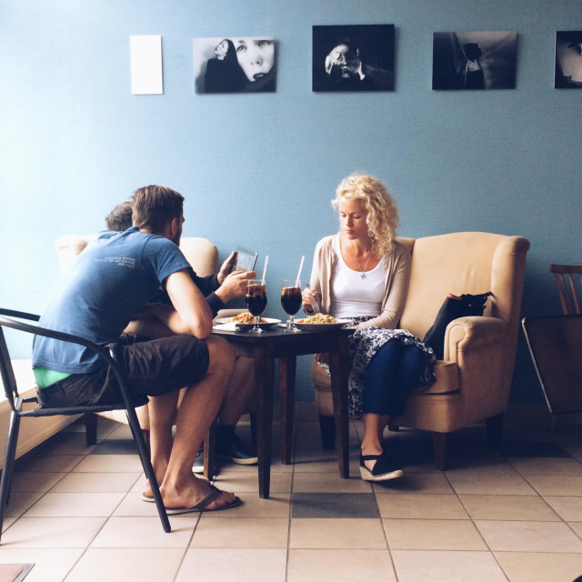 """Attractive young adults in conversation in cafe in Liepaja, Latvia"" stock image"