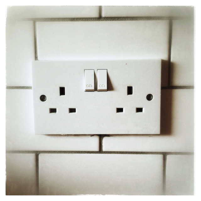 """Double pug socket on a tiled wall"" stock image"