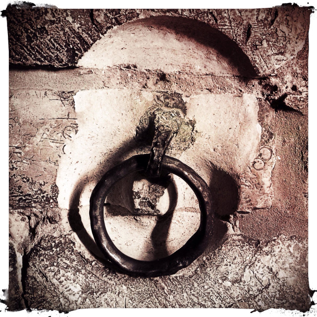 """An iron shackle in a medieval dungeon, Lincoln Castle, UK"" stock image"