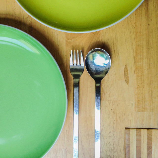 """""""Dinnerware and cutlery - plates, fork and spoon on wooden table"""" stock image"""