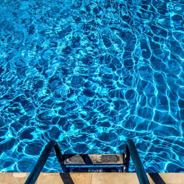 """Blue water in a Swimmingpool"" stock image"