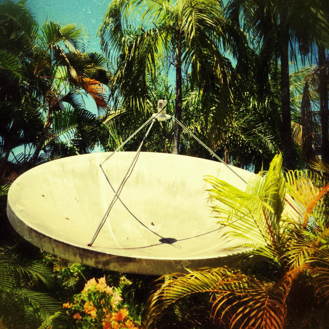 """A satellite dish in tropical Australia."" stock image"