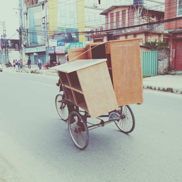"""Furniture delivery on a tricycle in Kathmandu, Nepal"" stock image"