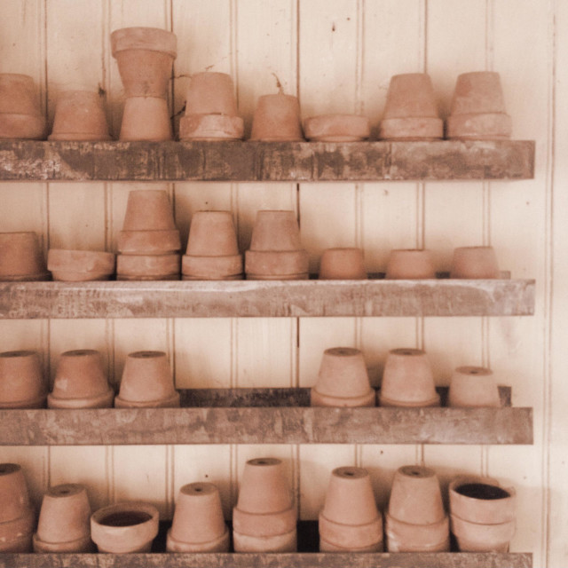 """Clay gardening pots stacked in shed"" stock image"