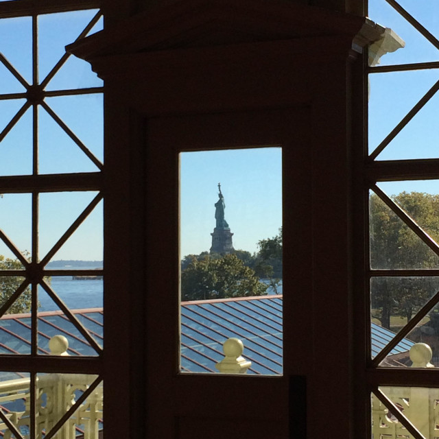 """The Statue of Liberty as seen from the Registration Room of the Ellis Island Immigration Museum in New York."" stock image"