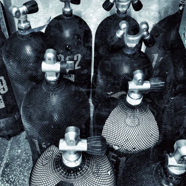 """Full scuba diving tanks stored upright"" stock image"