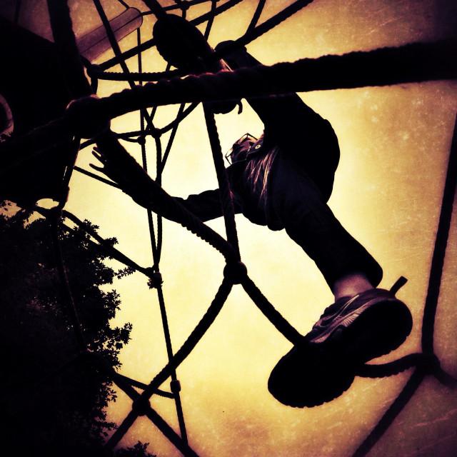 """Girl climbing rope climbing frame"" stock image"