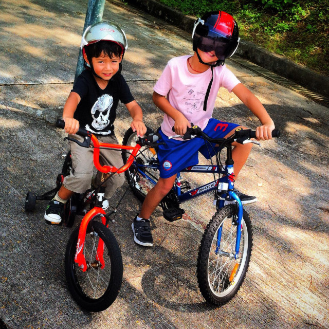 """""""Two brothers ready for biking. There wear helmet"""" stock image"""