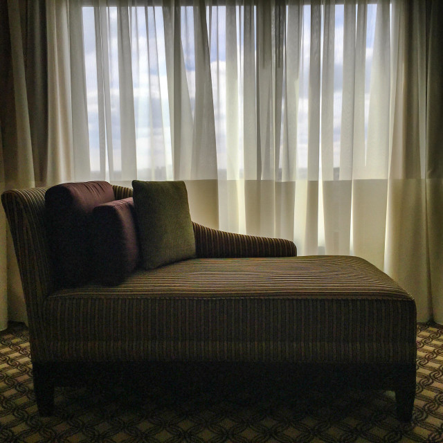 """""""Couch in hotel with window"""" stock image"""