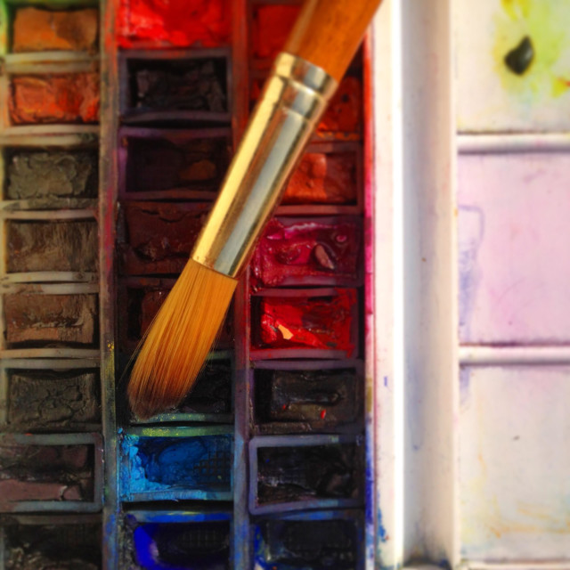 """Well used artists watercolour palette and brush"" stock image"