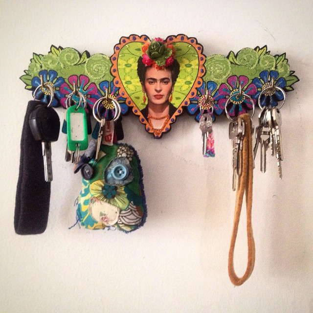 """A portrait of Mexican painter Frida Kalho inside a heart decorates a key holder in ""La luna de Romelia"" folk art studio in Mexico City, Mexico"" stock image"