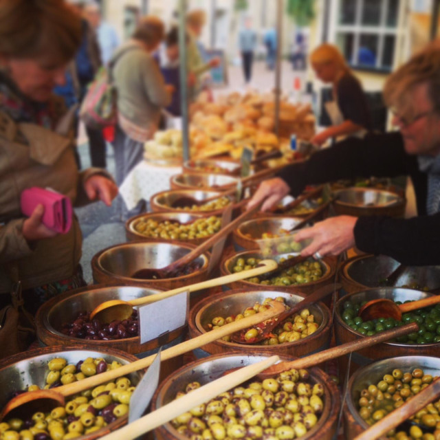 """Shopping for olives at Stroud farmers market, Gloucestershire, UK"" stock image"