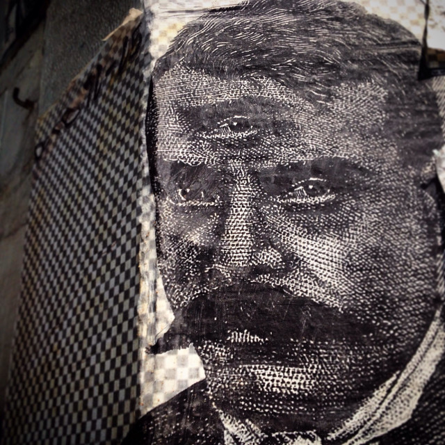 """A poster of Revolutionary Hero Emiliano Zapata with a third eye decorates a wall in Colonia Roma, Mexico City, Mexico"" stock image"