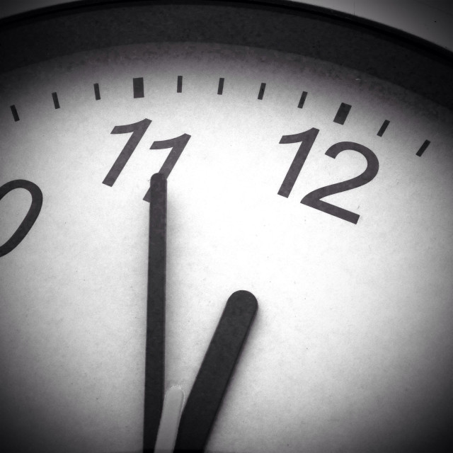 """""""Almost midnight on a black and white clock"""" stock image"""