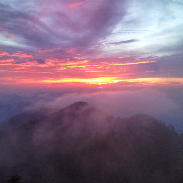 """A beautiful foggy sunset in the Smoky Mountains"" stock image"