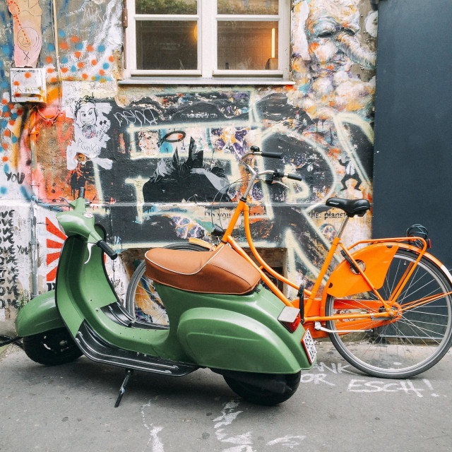 """""""Green scooter and orange bicycle"""" stock image"""