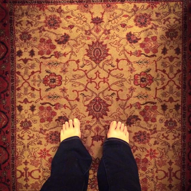 """Bare feet on rug"" stock image"