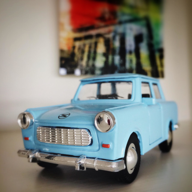 """Toy trabant car with picture of reichstag in background"" stock image"