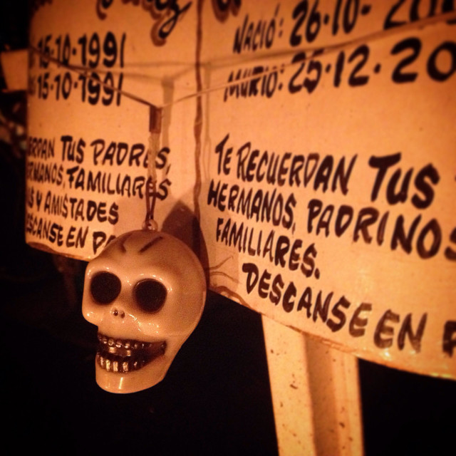 """""""A skull decorates a tomb of two children in San Gregorio Atlapulco cemetery during Day of the Dead celebrations in Xochimilco, Mexico City, Mexico"""" stock image"""