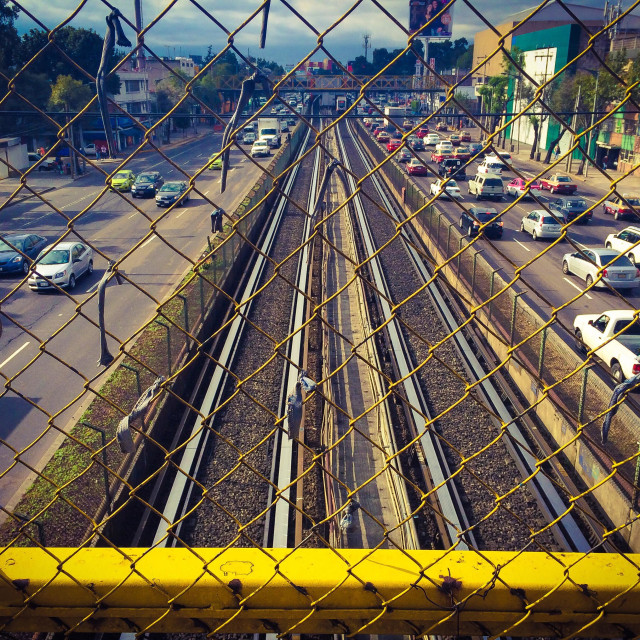 """Urban landscape. Cars and metro railway tracks under a bridge"" stock image"