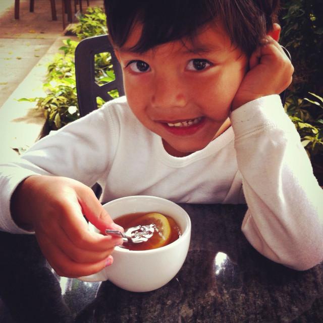 """""""Little cheeky boy is having a lemon tea"""" stock image"""