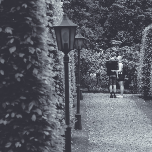 """Young couple in garden maze"" stock image"