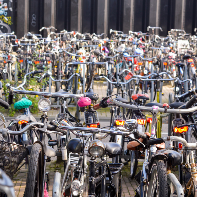 """Bicycles parked in the Amsterdam city center parking"" stock image"