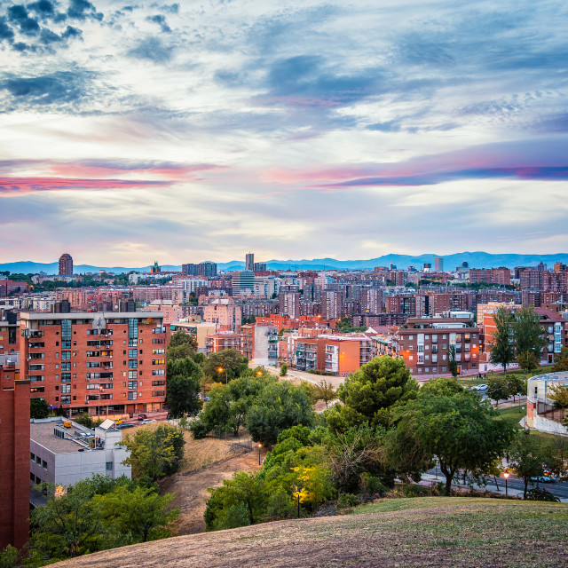 """Madrid cityscape at sunset with purple clouds"" stock image"