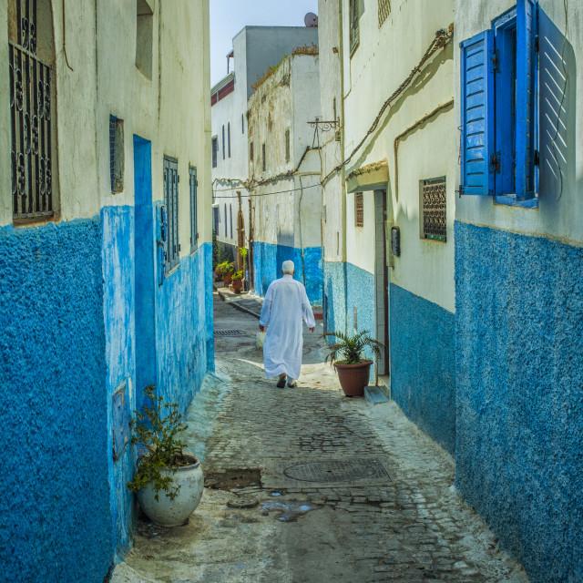 """""""Man in white djellaba walking in medina of Rabat"""" stock image"""