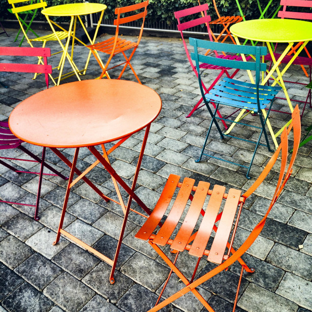"""""""Brightly coloured outdoor tables and chairs"""" stock image"""