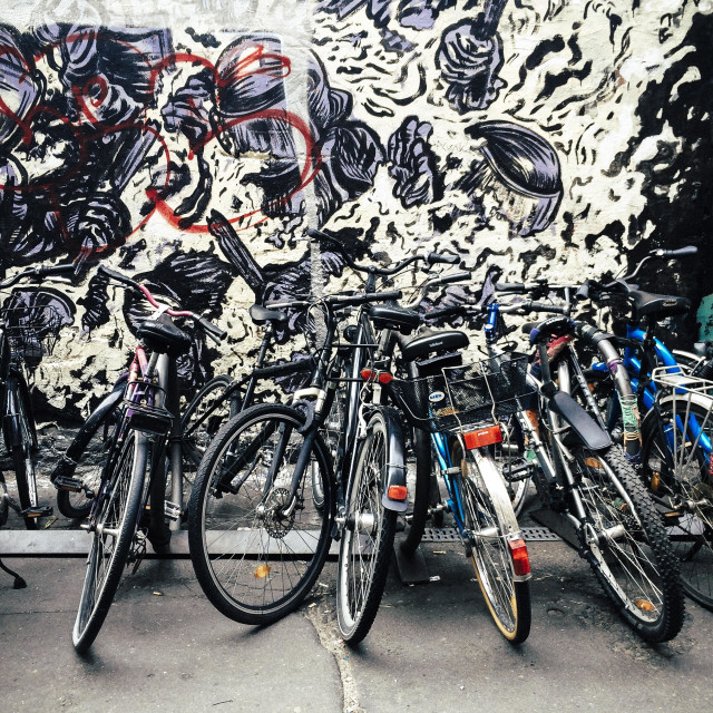 """""""Bicycles parked in front of wall with street art, Hackesche Hofe, Mitte, Berlin, Germany"""" stock image"""
