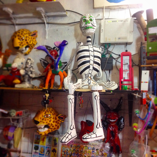 """A paper mache skeleton sits on the shells of Taller Tlamaxcalli toy store in Colonia Roma,Mexico City,Mexico"" stock image"