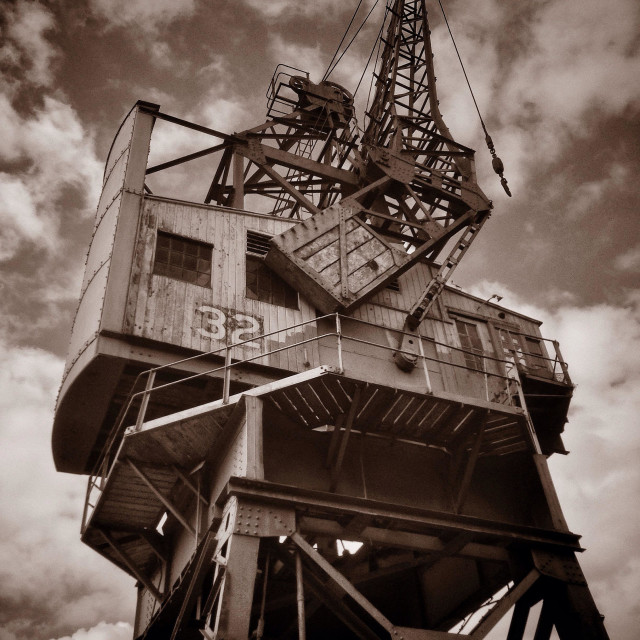 """""""A Large Crane, situated on the edge of The Floating Harbour close to the City Centre in Bristol, England. The Crane was used to off load cargo from ships. Photo Credit - © COLIN HOSKINS."""" stock image"""
