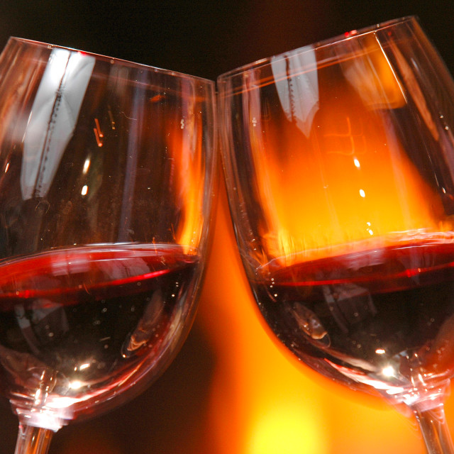 """""""Glass of wine beside the fire"""" stock image"""