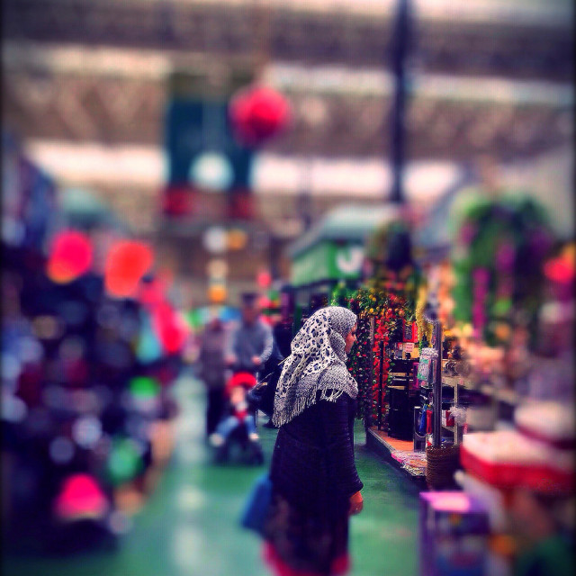 """Arab woman wearing a hijab shopping at Leeds market, West Yorkshire, UK"" stock image"