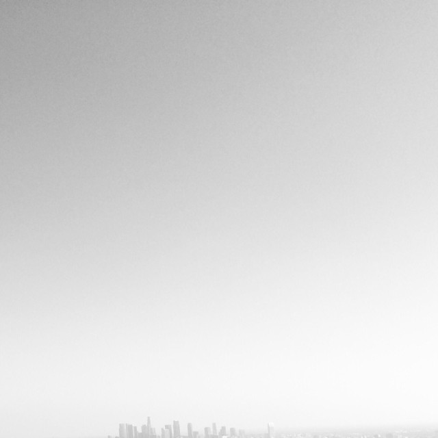 """""""Downtown Los Angeles in silhouette seen through a haze"""" stock image"""