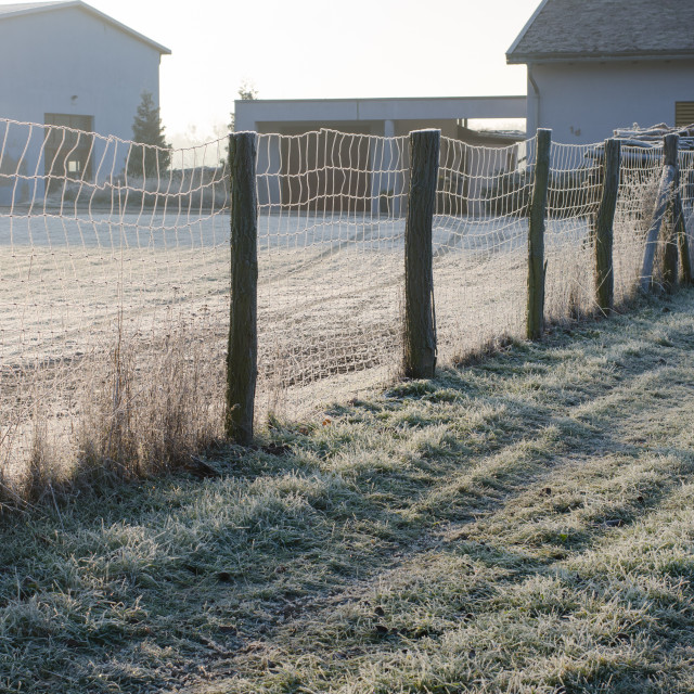 """""""Wooden Fence In The Frozen Countryside"""" stock image"""