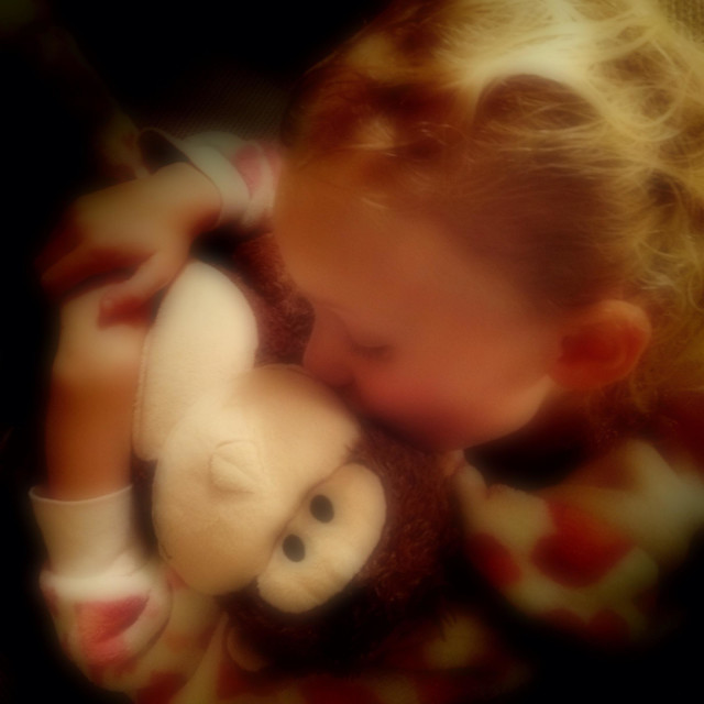 """""""Young girl cuddling soft toy"""" stock image"""