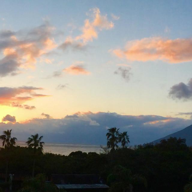 """Sunset over Mt. Kaimondake volcano, Satsuma Peninsula, Kyushu, Japan, panoramic"" stock image"